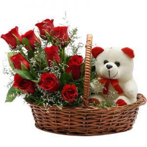 12 Fresh Red Roses With Teddy, Arranged Nicely in a Handle Basket