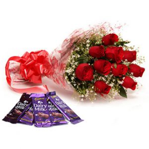 12 Red Roses Round Fancy Bunch with Big Satin Bow + 5 Cadbury Dairy Milk Chocolates