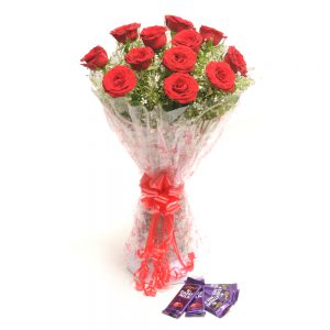 12 Red Roses Fancy Round Hand Bunch with Big Bow + 5 Dairy Milk Chocolates