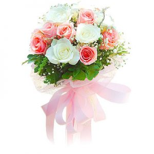 12 Pink & White Roses Bunch - This contemporary posy combines beautiful white roses with elegant pink roses. Its no coincidence that pink roses represent perfect happiness and this bouquet will melt someone's heart!