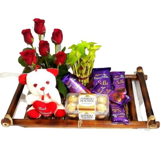 A SPECIAL COMBO – A 16 Pcs Ferrero Rocher Imported Swiss Chocolate Box + 1 Big & 4 Small Cadbury Dairy Milk Silk Chocolates + A 2 Layers Feng-Shui Good Luck Bamboo Plant + A Cute Teddy Bear Soft Toy + 6 Red Roses