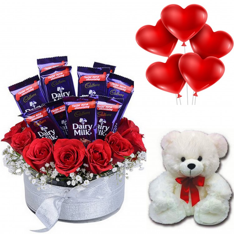 10 Cadbury Dairy Milk Chocolates With 10 Red Roses In A Glass Vase