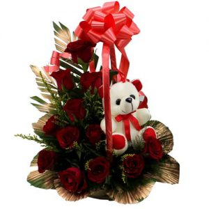 12 red roses and 1 teddy in a basket