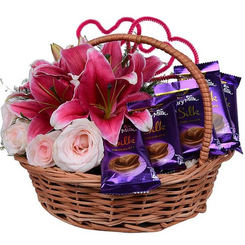 Basket contain 5 Pink Roses, 3 Oriental Lilies & 5 Cadbury Celebrations