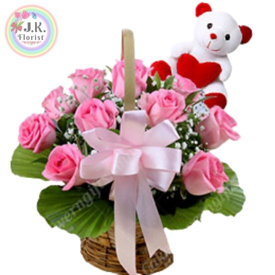 A Beautiful Basket of 10 Fresh Pink Roses with Pink Bow with a Small Teddy Bear Soft Toy